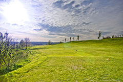 Golfcourse putting green. Idyllic golfcourse with putting green in front stock photography