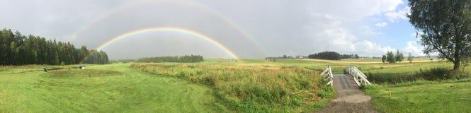 Golfcourse. Rainbow over a Norwegian golfcourse stock photography