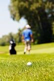 Golfcursus met spelers royalty-vrije stock foto's