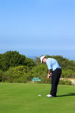 Golfer. Putting on the green Royalty Free Stock Photo