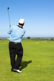 Golfer. Following the shot Stock Images