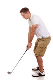Golfer. Young male golfer. Studio shot over white Royalty Free Stock Image