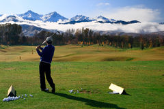 Golfer. On training filed. Great nature view Royalty Free Stock Images