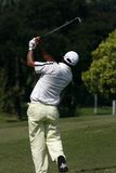 Golfer. A golfer playing golf in the field Royalty Free Stock Images