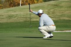 A golfer. Player in golf on field during tournament Royalty Free Stock Photos