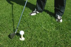 Golfer. Legs of a person practicing golf Royalty Free Stock Photography