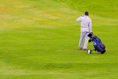 Golfer. A golfer with bag in the grass, looking in the distance Stock Photo