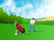 Golfer. Getting ready to strike the ball Royalty Free Stock Photos