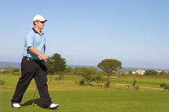 Golfer. Walking on the golf course. Copy space Royalty Free Stock Image
