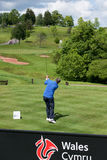 Golfer in action at the SSE Senior Open Wales Stock Image
