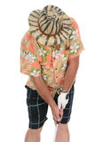 Golfer Addressing Ball. Closeup of an eclecticly dressed male tourist standing over a golf ball preparing to take his turn. He is wearing a Hawaiian shirt Royalty Free Stock Photos