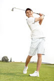 Golfer admiring the shot. He has just played Stock Image