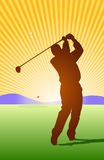 Golfer Afterswing. Golfer hitting ball toward the green Royalty Free Stock Photography