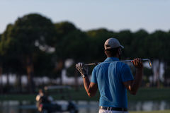 Golfer from back at course looking to hole in distance Royalty Free Stock Photos