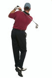 Golfer back swing rear view