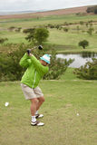 Golfer backswing. Golfer on top of backskwing before he hits the ball Stock Images