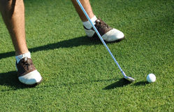 Golfer with ball and club. royalty free stock image