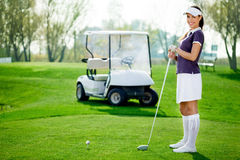 Golfer. Beautiful and young golfer with golf club Stock Images
