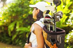 Golfer. Beautiful young woman as a golf player focus on equipment royalty free stock images