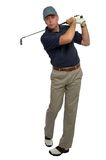 Golfer blue shirt iron shot Royalty Free Stock Photos