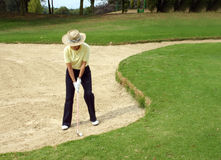 Golfer in bunker Stock Photo