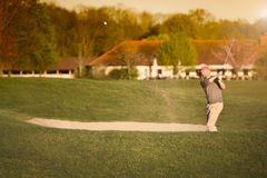 Golfer at bunker. Stock Images