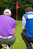 Golfer and caddy rear view. Stock Photos