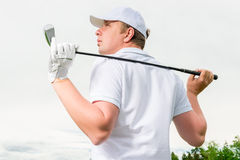 Golfer in a cap against the sky Royalty Free Stock Photos
