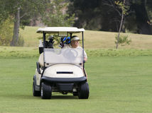 Golfer in Cart Royalty Free Stock Photos