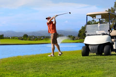 Golfer and cart Royalty Free Stock Photo