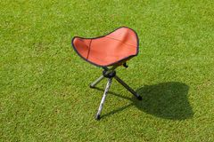 Golfer chair on green Royalty Free Stock Image