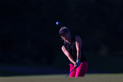 Girl Pro Golf Chip Ball Flight  Royalty Free Stock Images