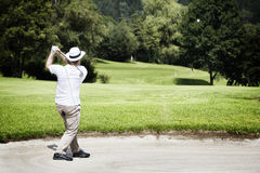 Golfer chipping in bunker. Royalty Free Stock Photo