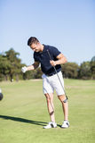 Golfer clenching fists. While standing on golf course Stock Images