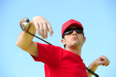 Golfer with club Stock Photography