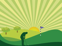 Golfer in countryside. Golfer silhouette in green rolling countryside with bright sun and sunburst sky Stock Photo