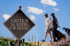 Golfer crossing Stock Photography