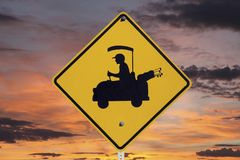 Golfer Crossing Sign with Sunrise Royalty Free Stock Photos