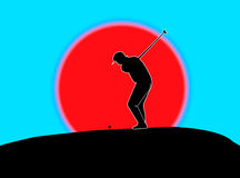 Golfer driving. /  the ball down range Royalty Free Stock Image