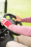 Golfer driving his golf buggy forward Royalty Free Stock Photography