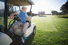 Golfer driving his golf buggy in reverse Royalty Free Stock Images