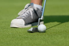 Golfer with driving-putter. Golfer, golf ball and driving-putter close-up Stock Photos