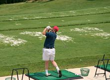 Golfer at Driving Range. Golfer at Swining at the Driving Range Royalty Free Stock Photography
