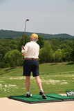 Golfer at Driving Range Stock Photo