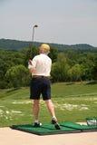 Golfer at Driving Range. Golfer at Swining at the Driving Range Stock Photo