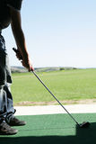 Golfer at driving range Royalty Free Stock Images
