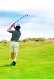 Golfer on the fairway. Golfer hitting the ball from the fairway. Golf club is in slight motion stock photos