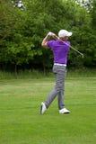 Golfer follow through. Male golfer in the follow through position after a mid iron fairway shot Stock Photos