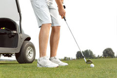 Golfer getting ready to hit the ball. Young golfer getting ready to hit the ball Stock Images