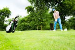 Golfer getting ready to hit the drive stock images